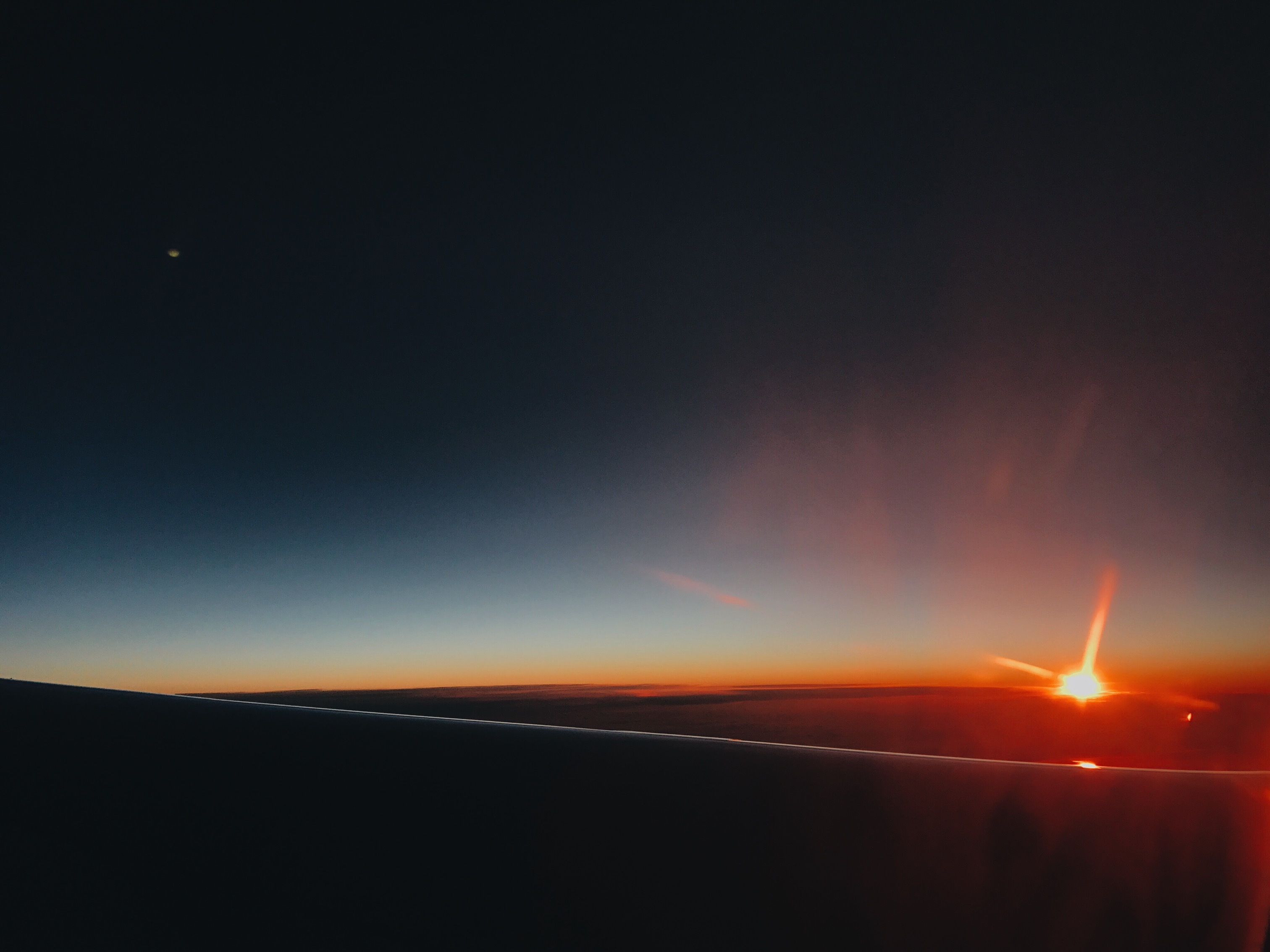 plane flying sunset
