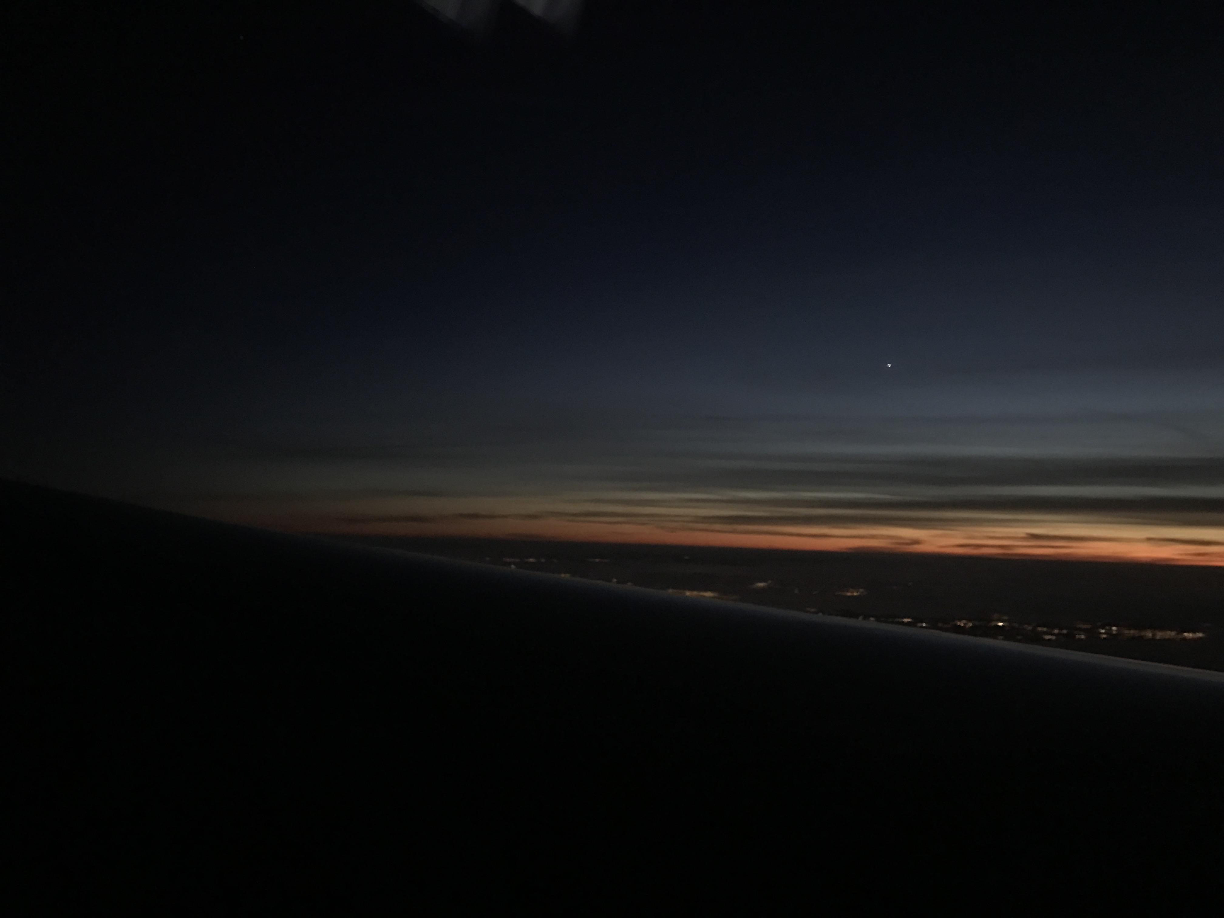plane flying sunset chicago